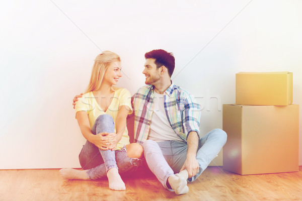 couple with cardboard boxes moving to new home Stock photo © dolgachov
