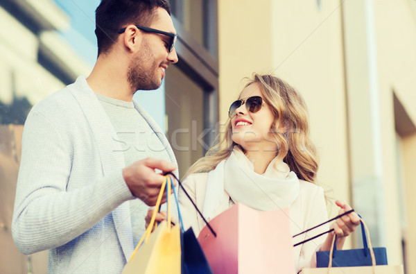 happy couple with shopping bags on city street Stock photo © dolgachov