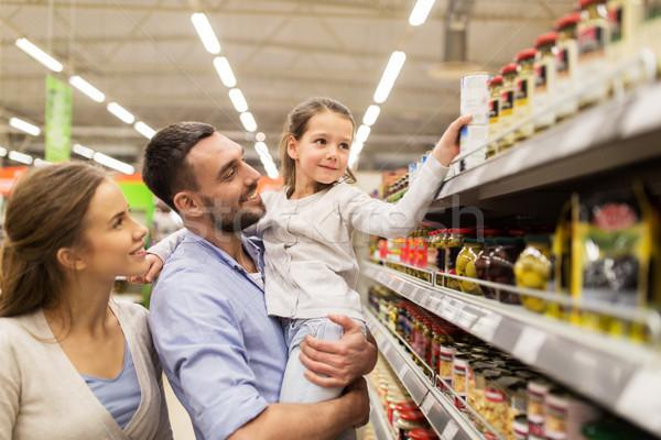 Familia feliz compra alimentos venta compras Foto stock © dolgachov