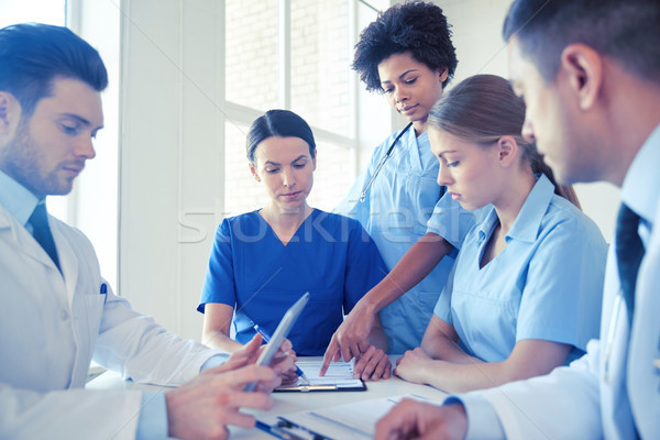 group of doctors meeting at hospital office Stock photo © dolgachov