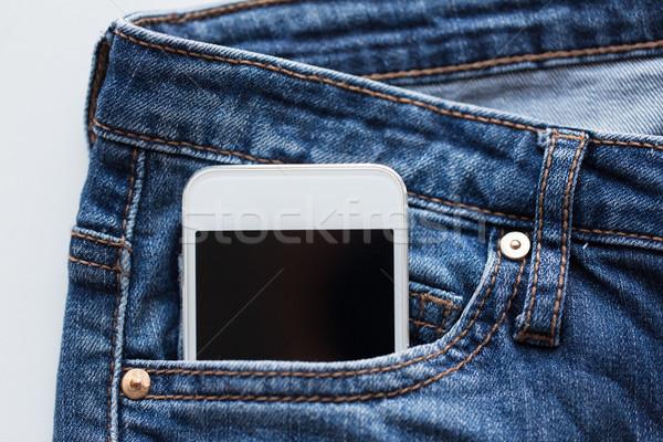 смартфон кармана джинсовой брюки джинсов технологий Сток-фото © dolgachov