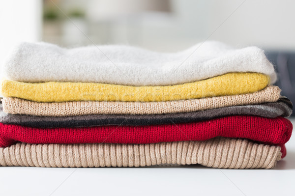 close up of stacked knitted clothes Stock photo © dolgachov