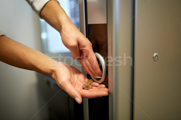 hands with euro coins at vending machine Stock photo © dolgachov