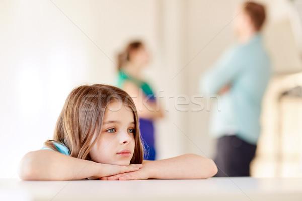 Stock photo: beautiful sad girl and parents arguing at home