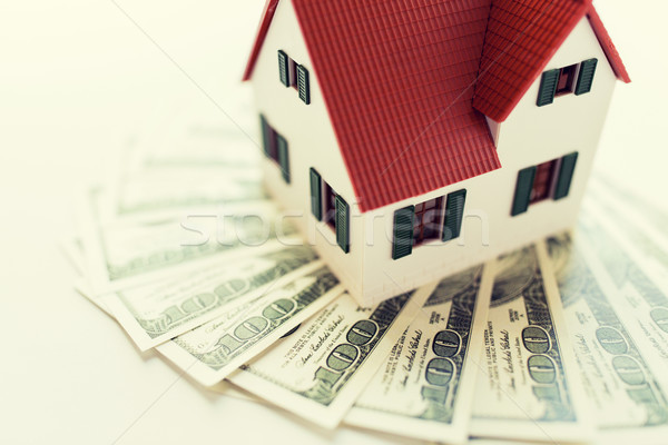 close up of home or house model and money Stock photo © dolgachov