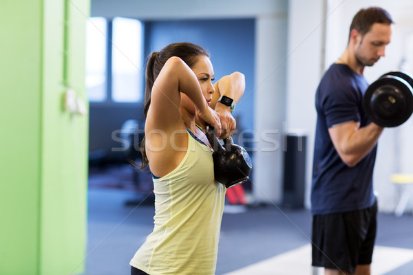 man and woman with kettlebell exercising in gym Stock photo © dolgachov