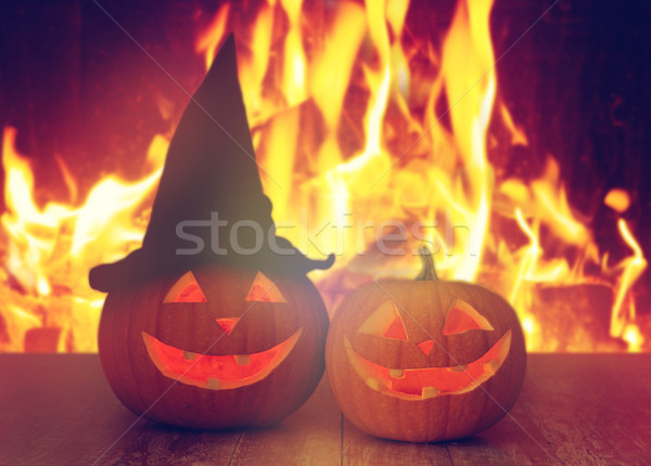 carved halloween pumpkins on table over fire Stock photo © dolgachov