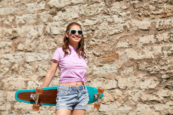 happy teenage girl in shades with longboard Stock photo © dolgachov