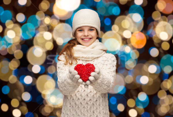 happy girl in winter clothes with red heart Stock photo © dolgachov