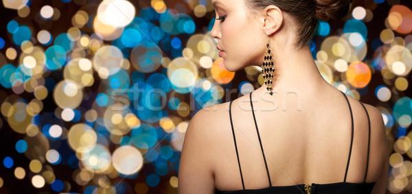 Mujer hermosa cara pendiente joyas Foto stock © dolgachov
