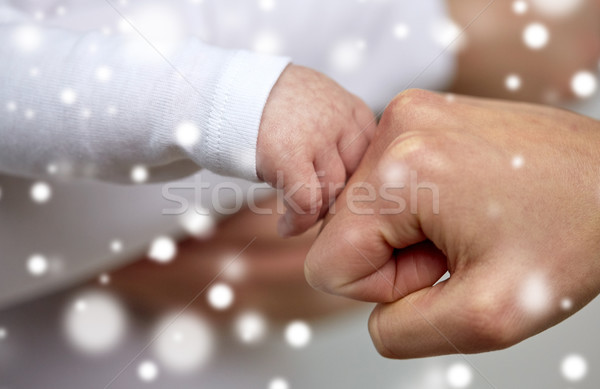 close up of mother and newborn baby hands Stock photo © dolgachov