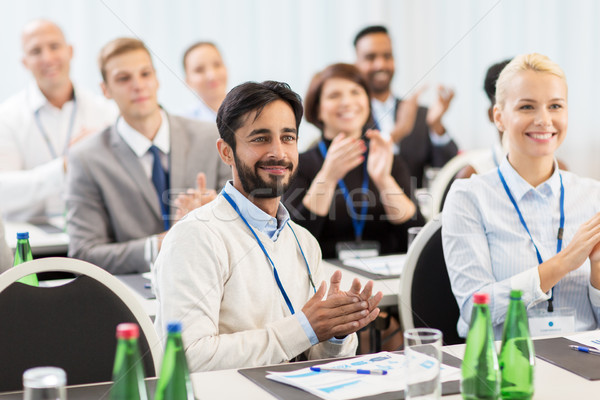 people applauding at business conference Stock photo © dolgachov