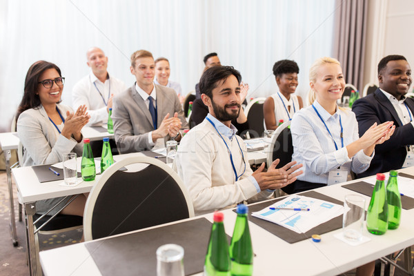 Stock photo: people applauding at business conference