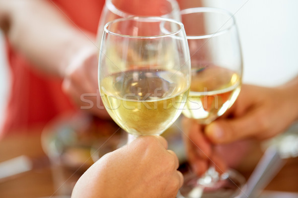 close up of hands clinking wine glasses Stock photo © dolgachov