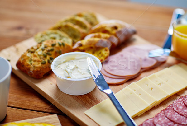 cream cheese and other food on table at breakfast Stock photo © dolgachov