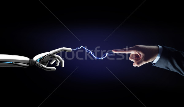 robot and human hand connected by lightning Stock photo © dolgachov