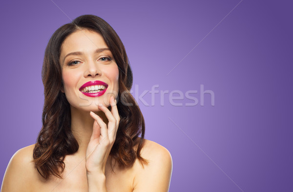 Stock photo: beautiful woman with lipstick over ultra violet