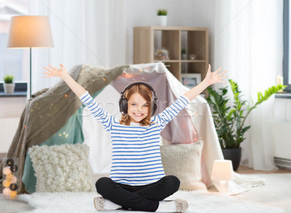 girl with headphones listening to music at home Stock photo © dolgachov