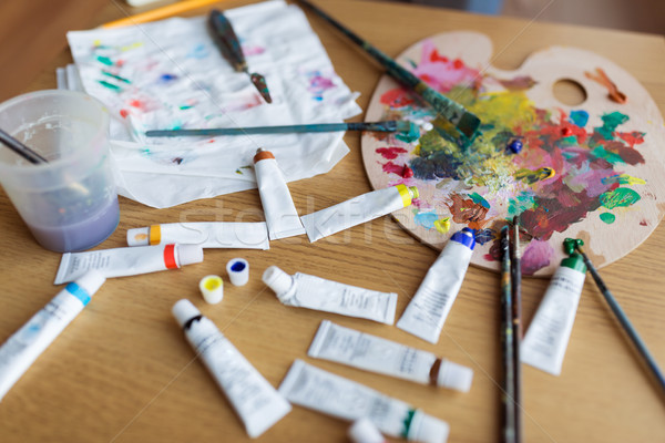 palette, brushes and paint tubes on table Stock photo © dolgachov