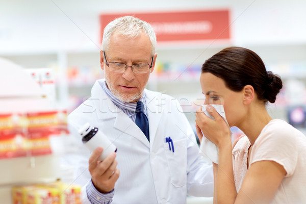 apothecary and sick customer at pharmacy Stock photo © dolgachov