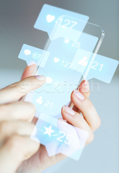 hands with social media icons on smartphone Stock photo © dolgachov