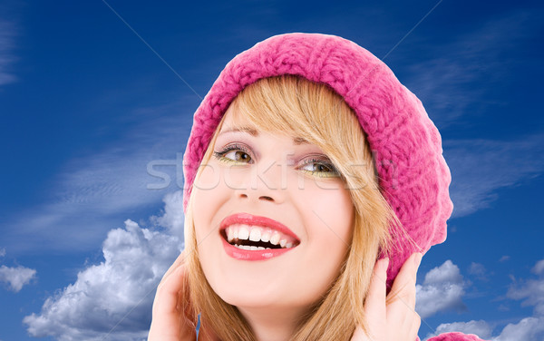 teenage girl in hat over winter sky Stock photo © dolgachov