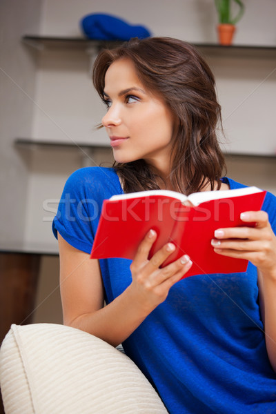 calm and serious woman with book Stock photo © dolgachov