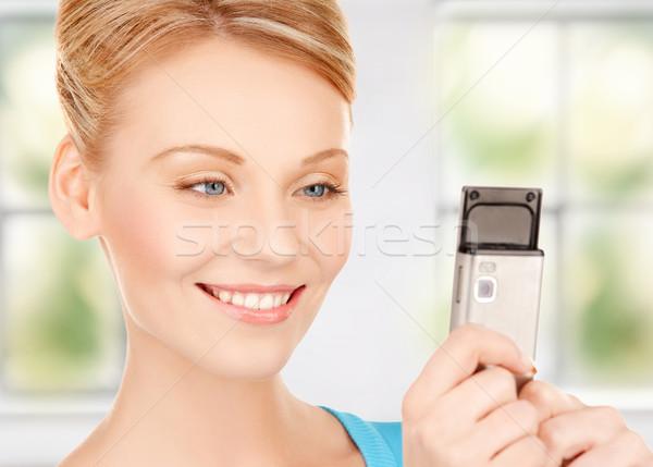 Femme téléphone portable lumineuses photos téléphone internet Photo stock © dolgachov