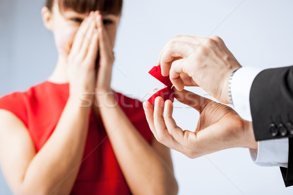 couple with wedding ring and gift box Stock photo © dolgachov