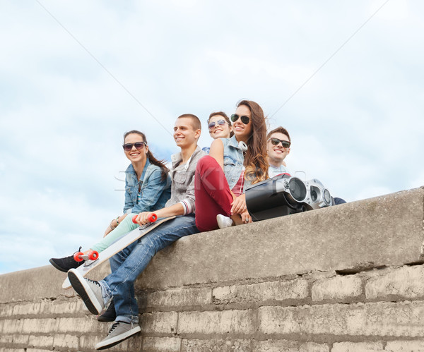 group of teenagers hanging outside Stock photo © dolgachov