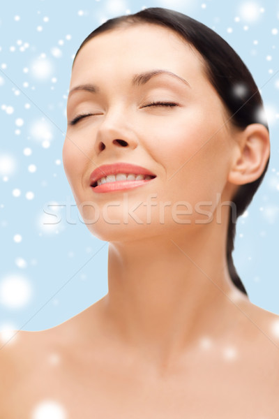 smiling young woman with closed eyes Stock photo © dolgachov
