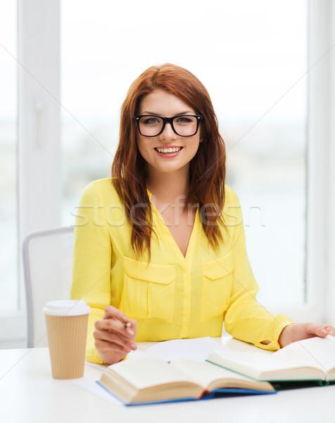 улыбаясь студент девушки чтение книгах библиотека Сток-фото © dolgachov