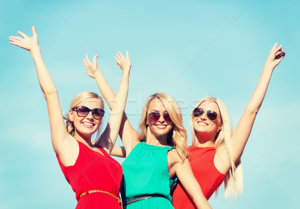 three beautiful women outdoors Stock photo © dolgachov