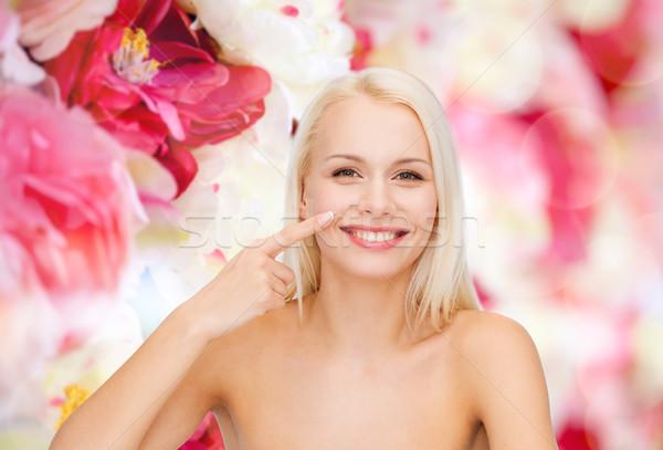 Mosolyog fiatal nő mutat orr egészség szépség Stock fotó © dolgachov
