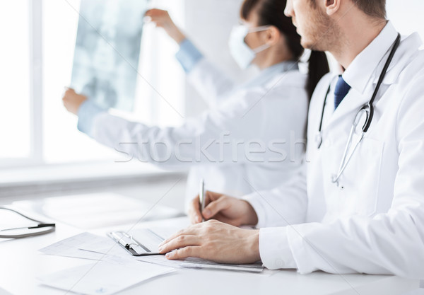doctor and nurse exploring x-ray Stock photo © dolgachov