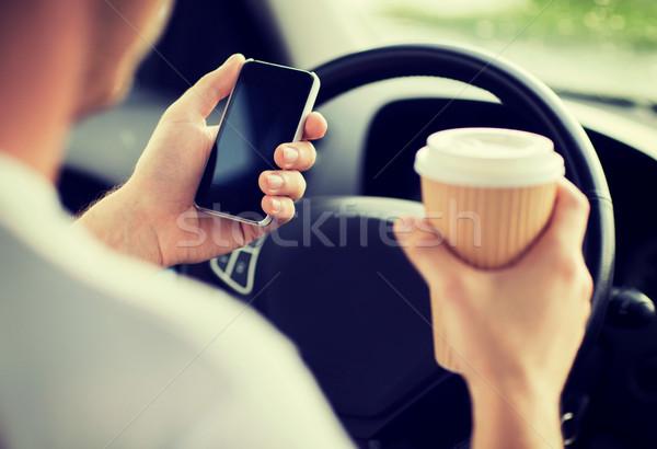 man using phone while driving the car Stock photo © dolgachov