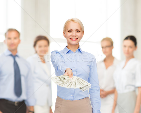 Stock photo: young businesswoman with dollar cash money