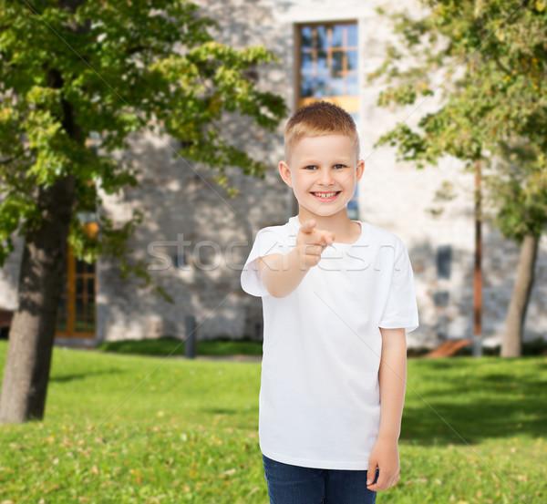 Mosolyog kicsi fiú fehér póló hirdetés Stock fotó © dolgachov