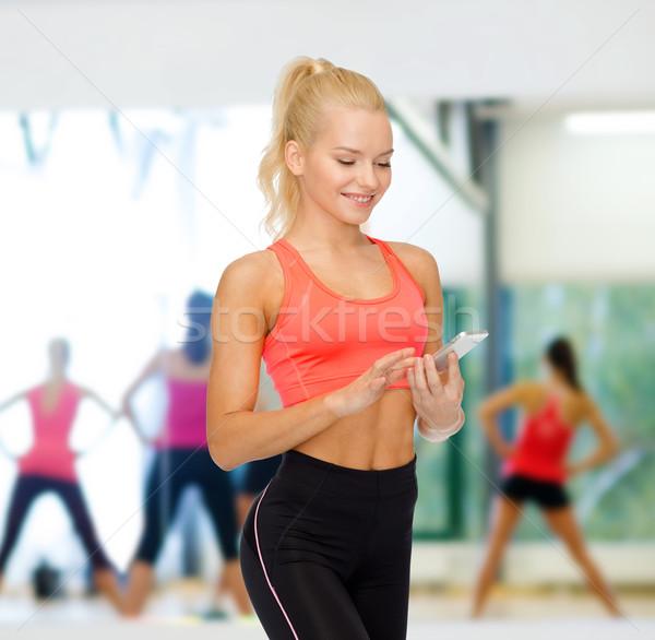 Souriant femme smartphone sport fitness Photo stock © dolgachov
