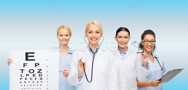 Foto stock: Sorridente · feminino · olho · médicos · saúde