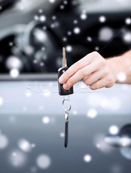 close up of man with car key outdoors Stock photo © dolgachov