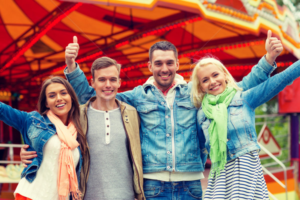 group of smiling friends showing thumbs up Stock photo © dolgachov