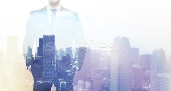 close up of businessman over city background Stock photo © dolgachov
