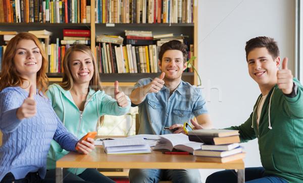 Stockfoto: Studenten · boeken · tonen · bibliotheek · mensen