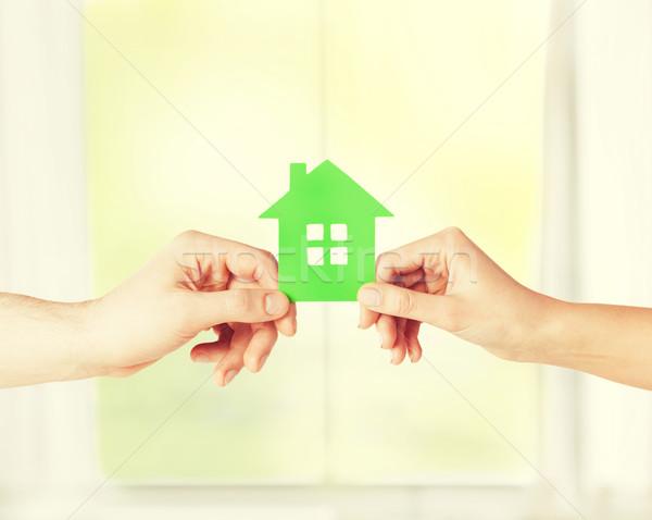 Pár kezek tart üvegház közelkép kép Stock fotó © dolgachov