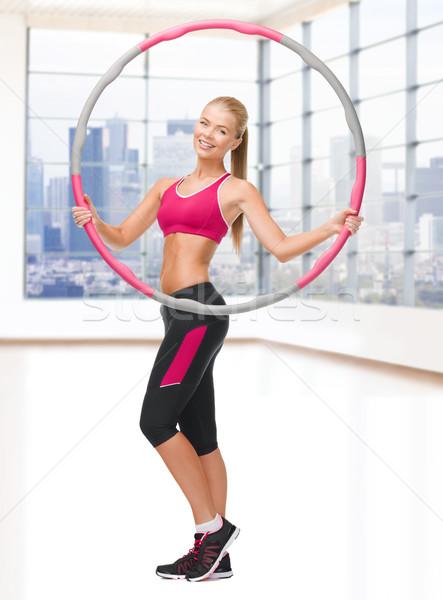 Jonge vrouw hoelahoep fitness sport Stockfoto © dolgachov