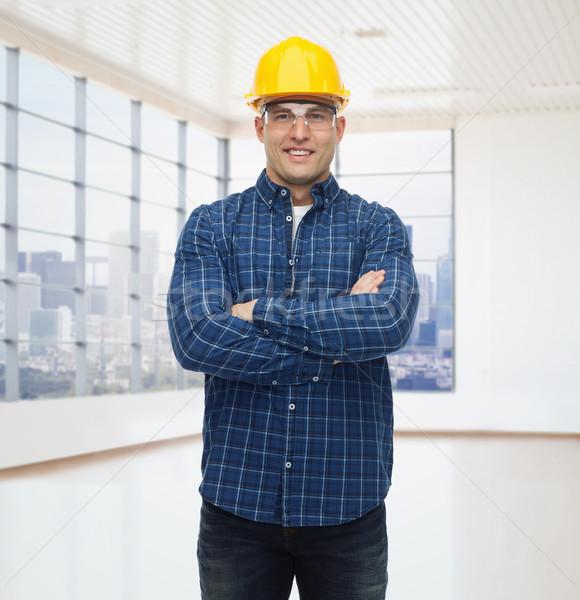 Sorridere maschio builder manuale lavoratore casco Foto d'archivio © dolgachov