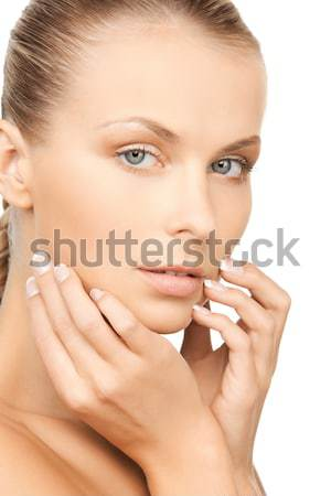 Stock photo: woman wearing shiny diamond earrings