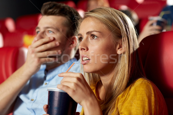 Stock photo: friends watching horror movie in theater