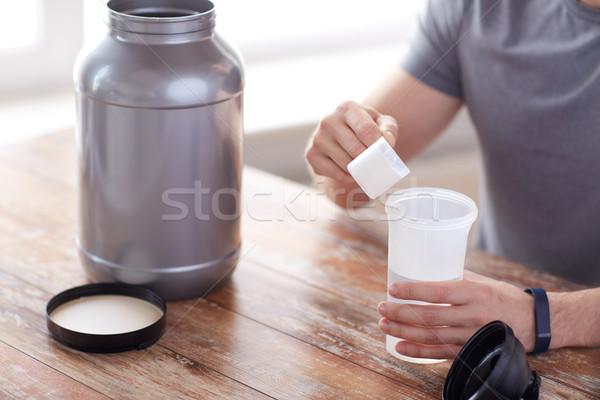 Adam protein sallamak şişe kavanoz Stok fotoğraf © dolgachov